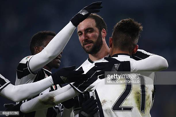 Juventus' forward Paulo Dybala from Argentina celebrates with teammate Juventus' forward Gonzalo Higuain after scoring during the Italian Serie A...