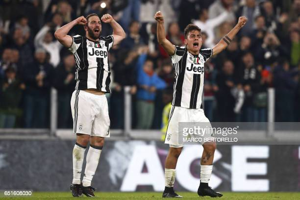 Juventus' forward Paulo Dybala from Argentina celebrates with teammate Gonzalo Higuain after scoring during the Italian Serie A football match...