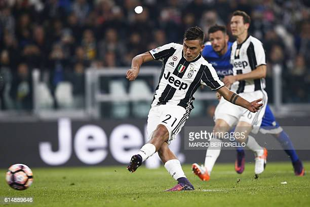 Juventus' forward Paulo Dybala from Argentina scores a penalty during the Italian Serie A football match Juventus vs Udinese on October 15 2016 at...