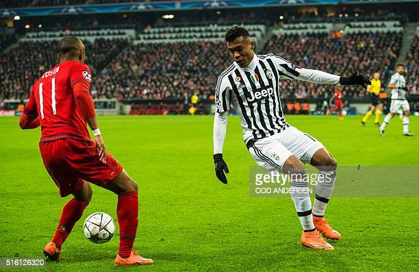 Juventus forward Sebastian Giovinco and Bayern Munich's Brazilian midfielder Douglas Costa vie for the ball during the UEFA Champions League Round of...