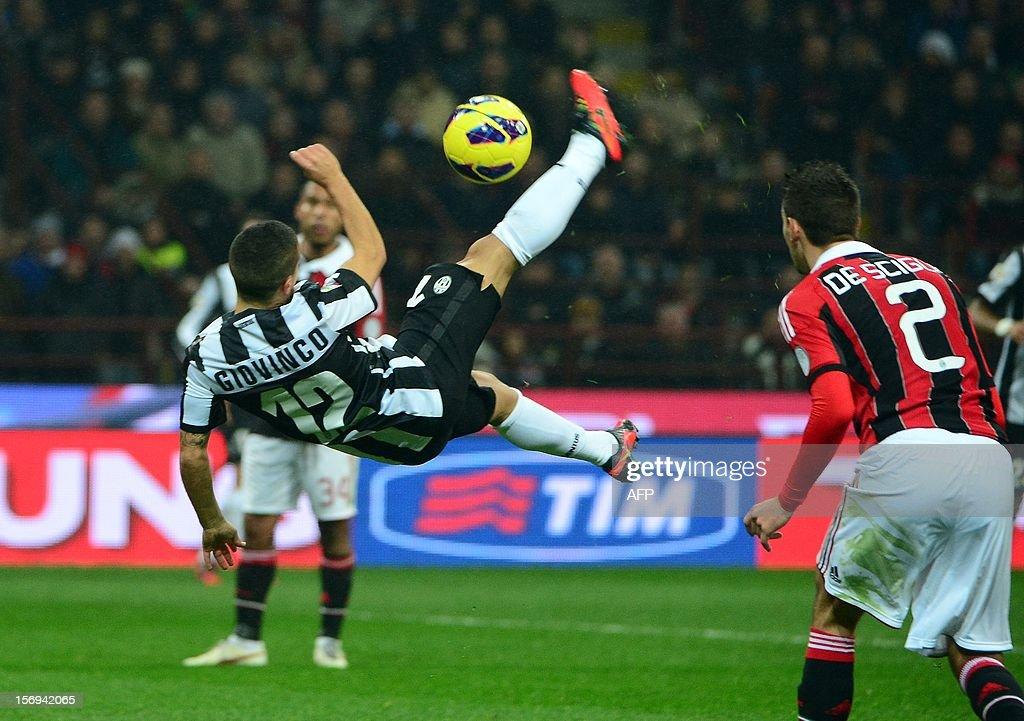 Juventus' forward Sebastian Giovinco (L) kicks the ball during the Italian serie A football match between AC Milan and Juventus on November 25, 2012 at the San Siro stadium in Milan.