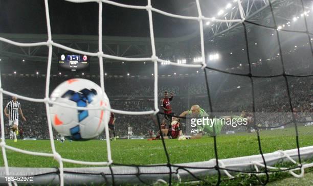 Juventus' forward Sebastian Giovinco scores against AC Milan's goalkeeper Christian Abbiati during the Serie A football match Juventus vs AC Milan on...