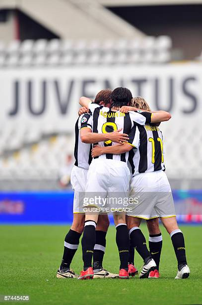 Juventus forward Vincenzo Iaquinta celebrates after scoring with Juventus Czech midfielder Pavel Nedved and Juventus midfielder Cristiano Zanetti...