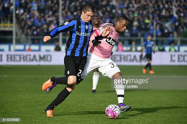 Juventus' French defender Patrice Evra fights for the ball with Atalanta's Italian defender Andrea Conti during the Italian Serie A football match...