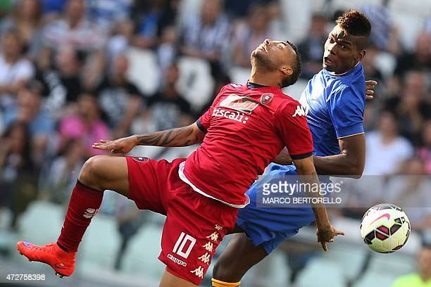 Juventus' French midfielder Labile Paul Pogba fights for the ball with Cagliari's Brazilian forward Joao Pedro Geraldino Dos Santos Galvao during the...