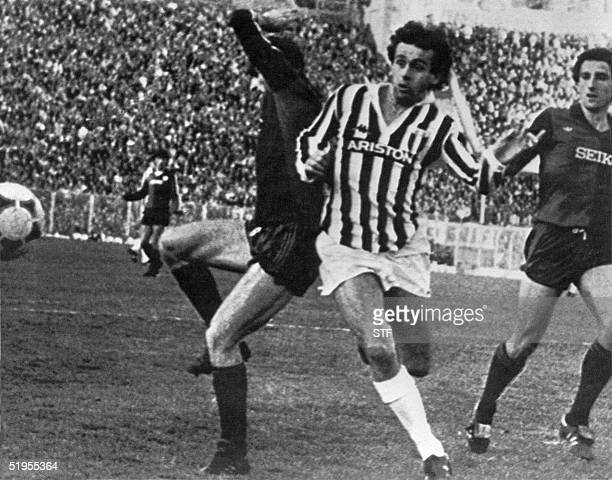 Juventus French midfielder Michel Platini struggles with Genoa defender Mario Faccenda during their match 01 December 1983 in Genoa