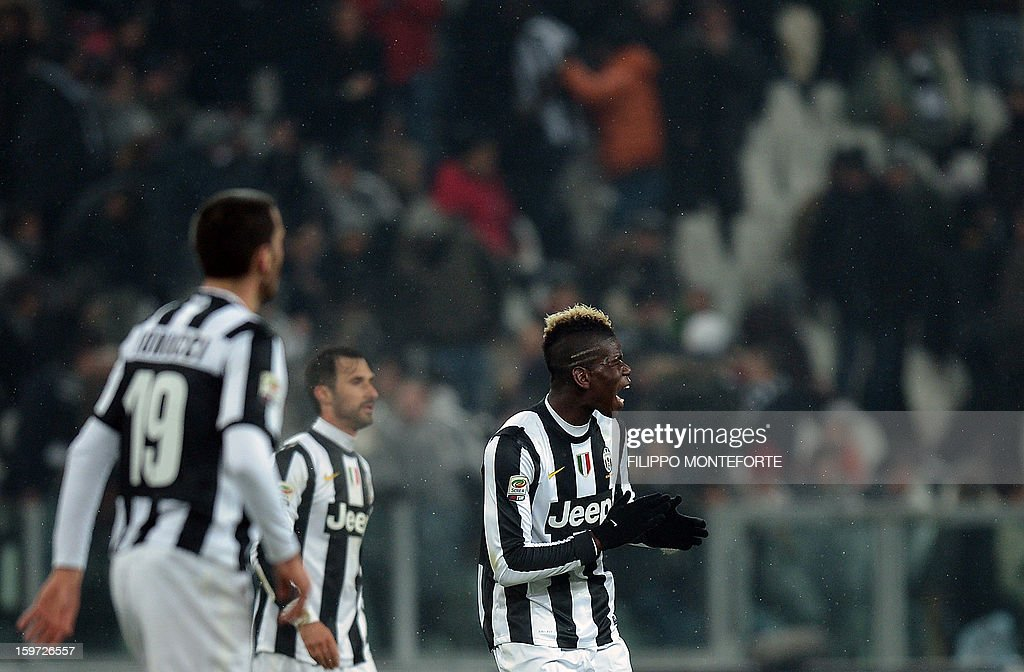 Juventus' French midfielder Paul Pogba (R) celebrates after scoring against Udinese during their Serie A football match in Turin's Juventus Stadium on January 19, 2013. AFP PHOTO / FILIPPO MONTEFORTE