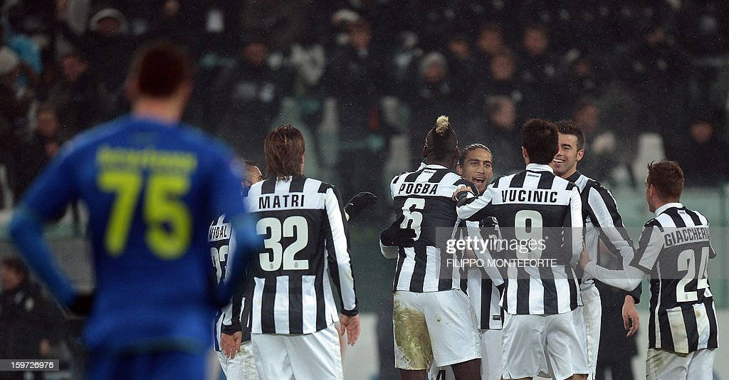 Juventus' French midfielder Paul Pogba (C) celebrates after scoring against Udinese during their Serie A football match in Turin's Juventus Stadium on January 19, 2013.