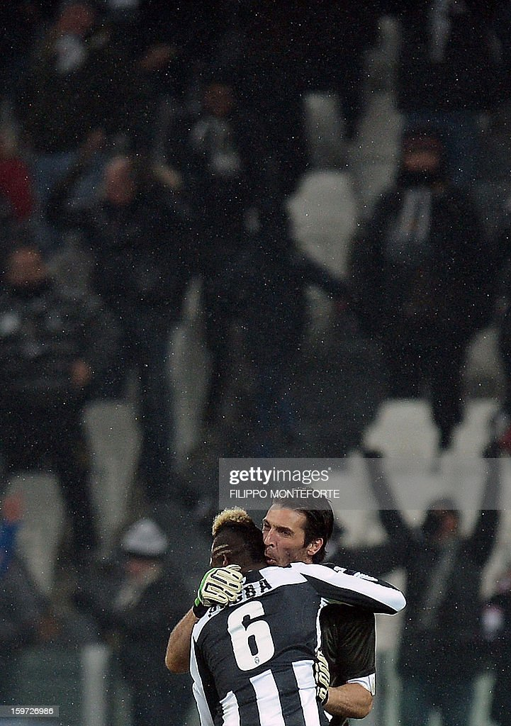 Juventus' French midfielder Paul Pogba (C) celebrates with goalkeeper Gianluigi Buffon after scoring against Udinese during their Serie A football match in Turin's Juventus Stadium on January 19, 2013.