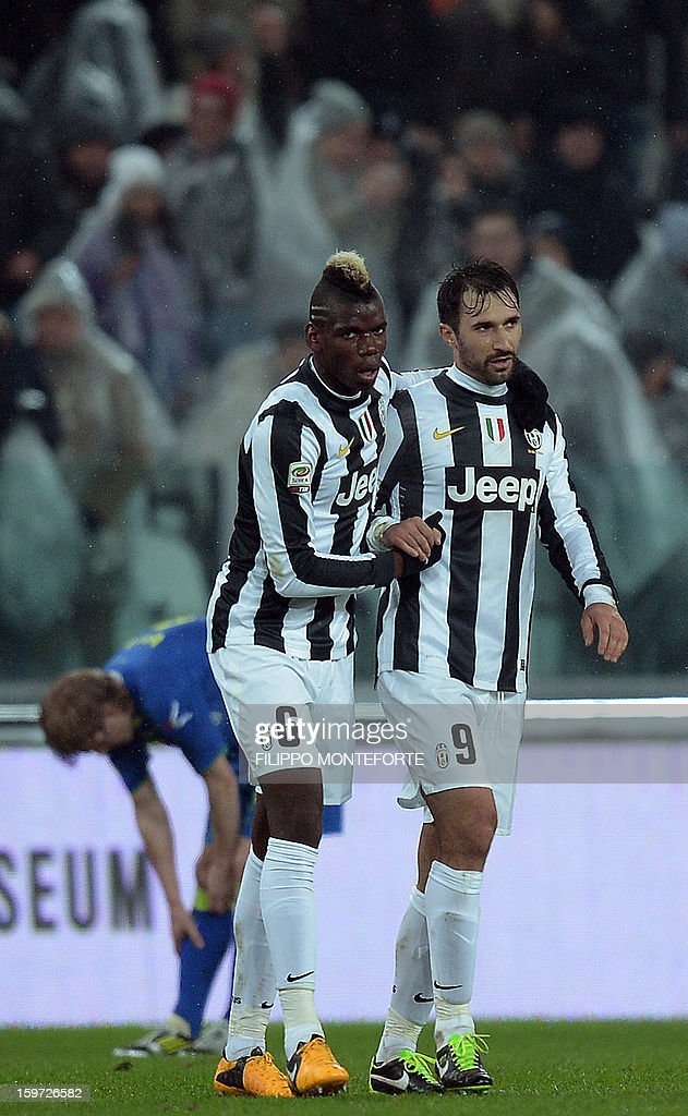 Juventus' French midfielder Paul Pogba celebrates with teamate forward of Montenegro Mirko Vucinic (R) after scoring against Udinese during their Serie A football match in Turin's Juventus Stadium on January 19, 2013.