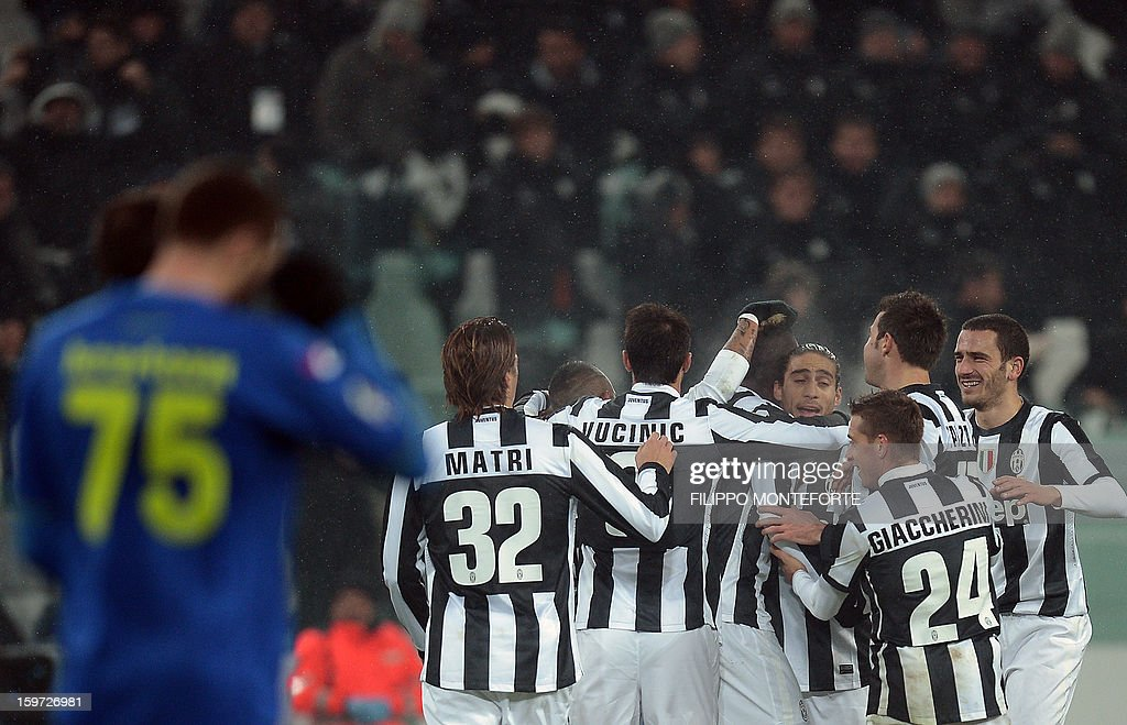 Juventus' French midfielder Paul Pogba (C) celebrates with teammates after scoring against Udinese during their Serie A football match in Turin's Juventus Stadium on January 19, 2013.