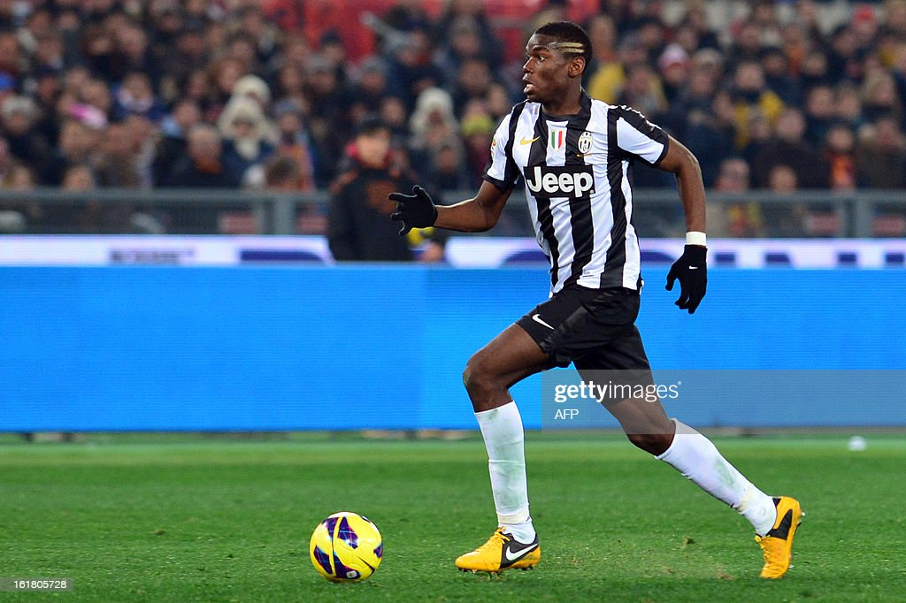 Juventus' French midfielder Paul Pogba controls the ball during the Italian Serie A football match between AS Roma and Juventus on February 16, 2013 at the Olympic Stadium in Rome. AS Roma defeated Juventus 1-0.