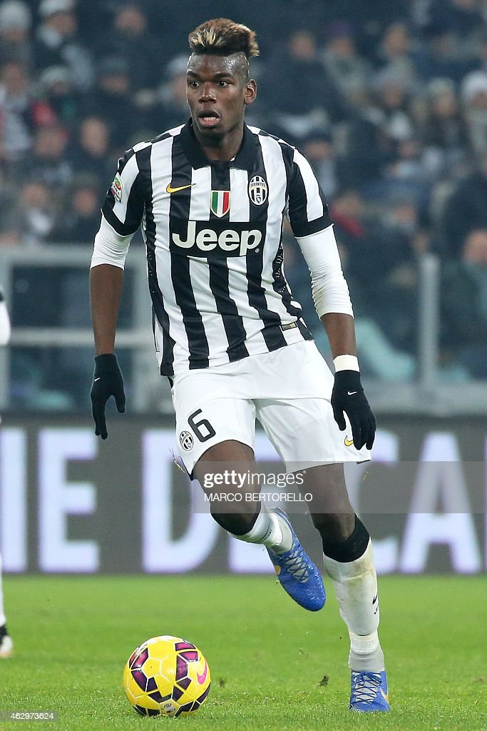 Juventus' French midfielder Paul Pogba controls the ball during the Italian Serie A football match Juventus Vs AC Milan on February 7, 2015 at the 'Juventus Stadium' in Turin. AFP PHOTO / MARCO BERTORELLO