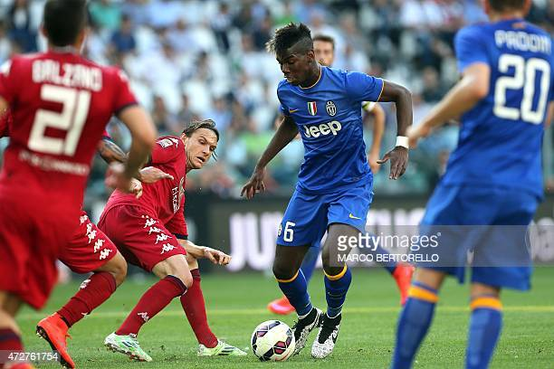 Juventus' French midfielder Paul Pogba fights for the ball with Cagliari's Swedish midfielder Albin Ekdal during the Italian Serie A football match...
