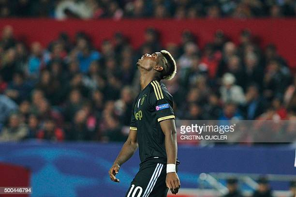 Juventus' French midfielder Paul Pogba reacts after missing a goal opportunity during the UEFA Champions League Group D football match Sevilla FC vs...