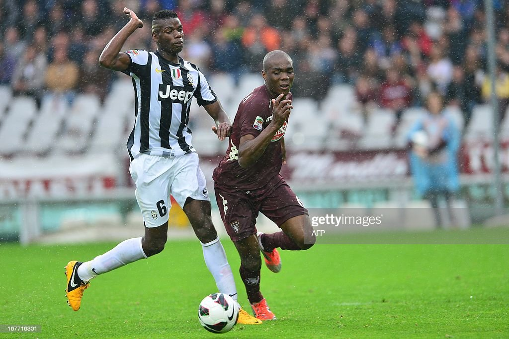 Juventus' French midfielder Paul Pogba (L) vies for the ball with Torino's Italian defender Angelo Obinze Ogbonna during the Italian Serie A football match between Torino and Juventus on April 28, 2013 at the Olympic Stadium in Turin.