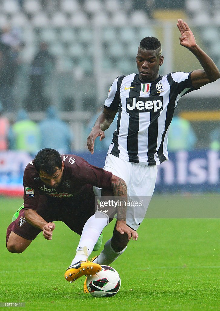 Juventus' French midfielder Paul Pogba (R) vies for the ball with Torino's Italian midfielder Mari Albertoo Santana during the Italian Serie A football match between Torino and Juventus on April 28, 2013 at the Olympic Stadium in Turin. AFP PHOTO / GIUSEPPE CACACE