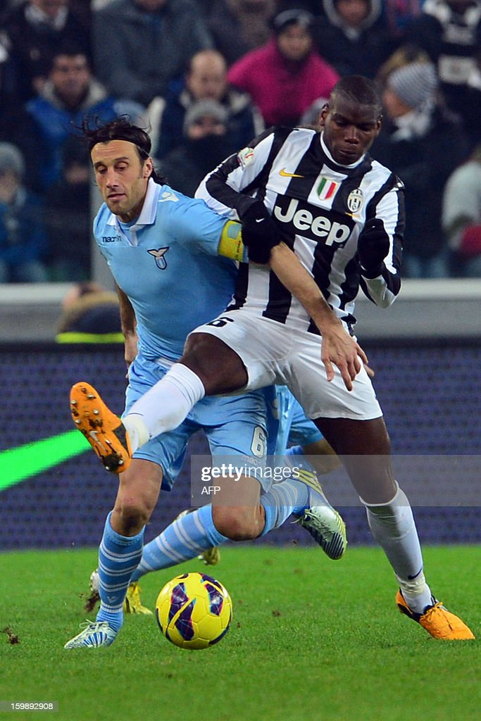 Juventus' French midfielder Paul Pogba (R) vies with Lazio's midfielder Stefano Mauri during their TIM CUP football match between Juventus and Lazio at the 'Juventus Stadium' in Turin on January 22, 2013. AFP PHOTO / GIUSEPPE CACACE