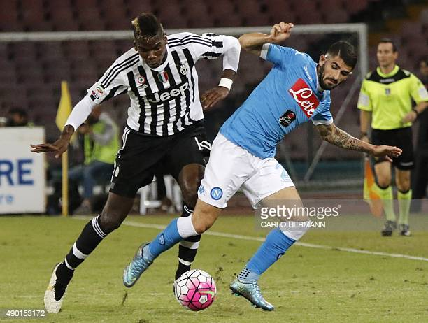 Juventus' French midfielder Paul Pogba vies with Napoli's Albanian defender Elseid Hysaj during the Italian Serie A football match SSC Napoli vs FC...