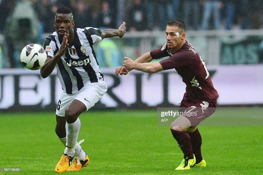 Juventus' French midfielder Paul Pogba (L) vies with Torino's defender Salvatore Masiello during an Italian Seria A football match between Torino and Juventus at the Olympic Stadium in Turin on April 28, 2013. AFP PHOTO / GIUSEPPE CACACE