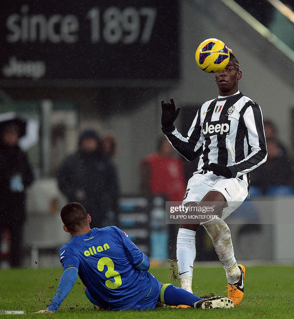 Juventus' French midfielder Paul Pogba (R) vies with Udinese's Brazilian midfielder Allan Marques Loureiro during their Serie A football match in Turin's Juventus Stadium on January 19, 2013.