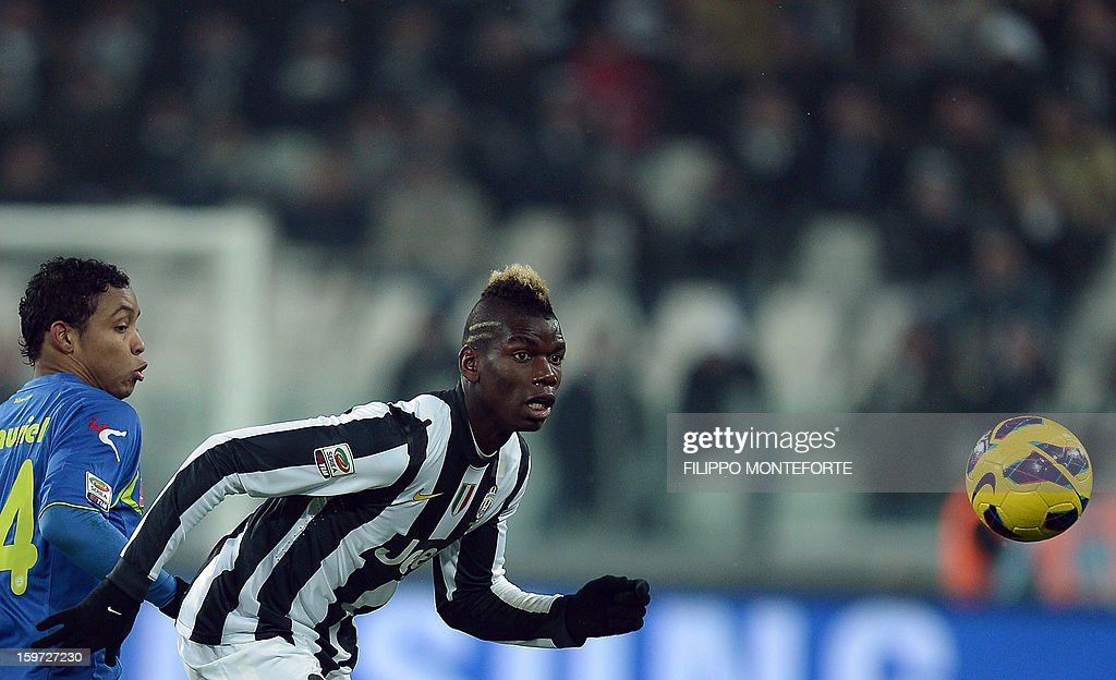 Juventus' French midfielder Paul Pogba (R) vies with Udinese's forward of Colombia Muriel Fruto Luis Fernando during their Serie A football match in Turin's Juventus Stadium on January 19, 2013. AFP PHOTO / FILIPPO MONTEFORTE