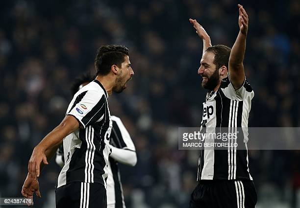 Juventus' German midfielder Sami Khedira celebrates with Juventus' Argentinian forward Gonzalo Higuain after scoring a goal during the Italian Serie...