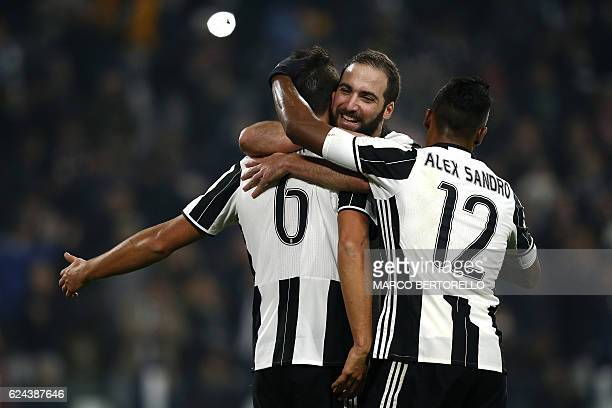 Juventus' German midfielder Sami Khedira celebrates with Juventus' Argentinian forward Gonzalo Higuain and Juventus' Brazilian defender Alex Sandro...