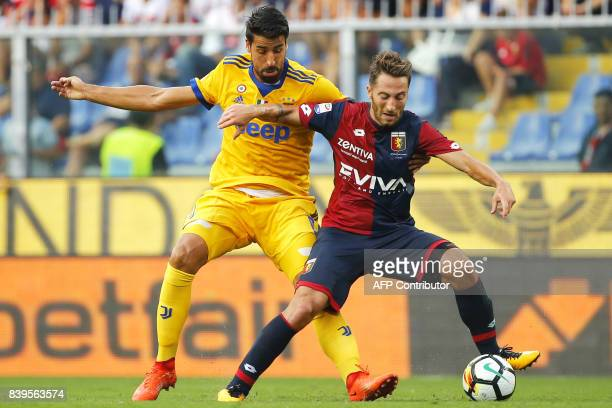 Juventus' German midfielder Sami Khedira fights for the ball with Genoa's Italian midfielder Andrea Bertolacci during the Italian Serie A football...