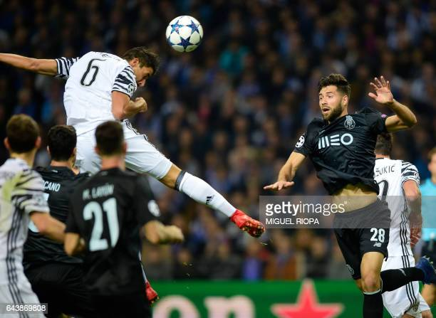 Juventus' German midfielder Sami Khedira heads the ball next to Porto's Brazilian defender Felipe during the UEFA Champions League round of 16 second...