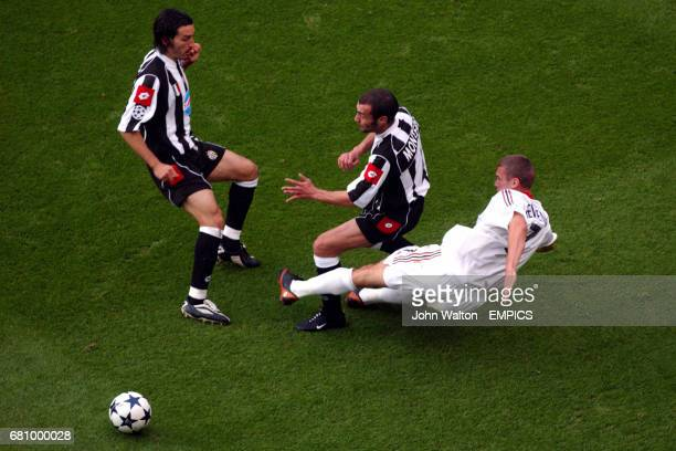 Juventus' Gianluca Zambrotta and teammate Paolo Montero battle for the ball with AC Milan's Andriy Shevchenko