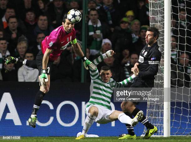 Juventus' Gianluigi Buffon Celtic's Gary Hooper and Juventus' Stephen Lichtsteiner battle for the ball during the UEFA Champions League Round of...