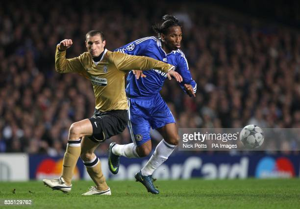 Juventus' Giorgio Chiellini and Chelsea's Didier Drogba battle for the ball