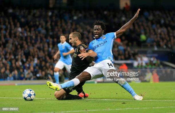 Juventus' Giorgio Chiellini and Manchester City's Wilfried Bony battle for the ball