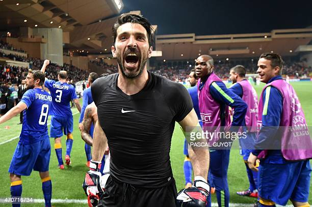 Juventus' goalkeeper and captain Gianluigi Buffon celebrates after qualifying for the semifinals of the UEFA Champions League following the quarter...