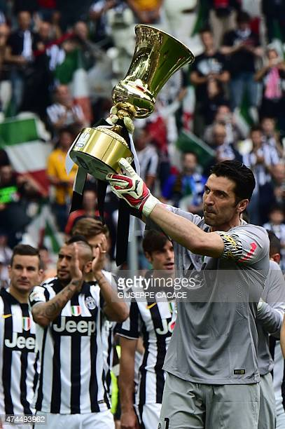 Juventus' goalkeeper and captain Gianluigi Buffon holds the Cup as players present the Tim Cup trophy to their fans prior the Italian Serie A...