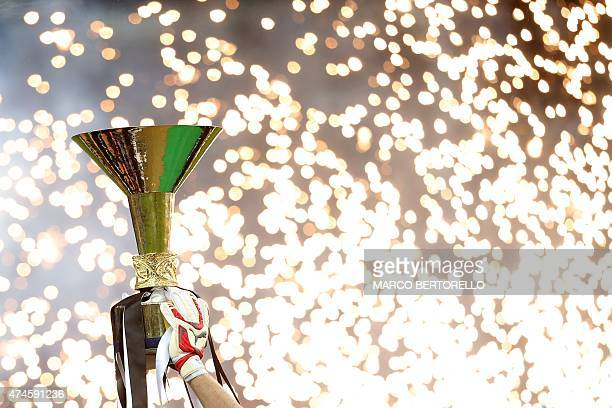 Juventus' goalkeeper and captain Gianluigi Buffon holds the Italian League's trophy during a ceremony following the Italian Serie A football match...