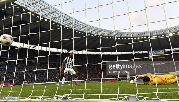 Juventus' goalkeeper and captain Gianluigi Buffon misses a goal from Barcelona's Croatian midfielder Ivan Rakitic during the UEFA Champions League...