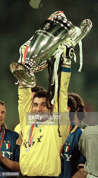 Juventus goalkeeper Angelo Peruzzi holding the trophy aloft after the UEFA Champions League Final between Ajax and Juventus at the Olympic Stadium in...