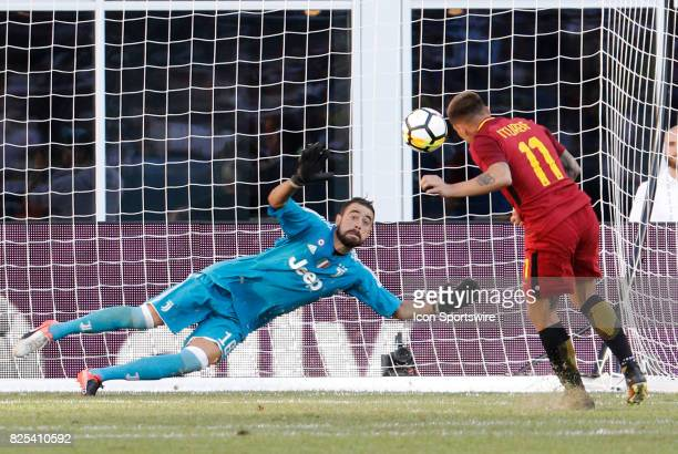 Juventus goalkeeper Carlo Pinsoglio eyes the penalty kick from Roma forward Juan Iturbe during an International Champions Cup match between AS Roma...