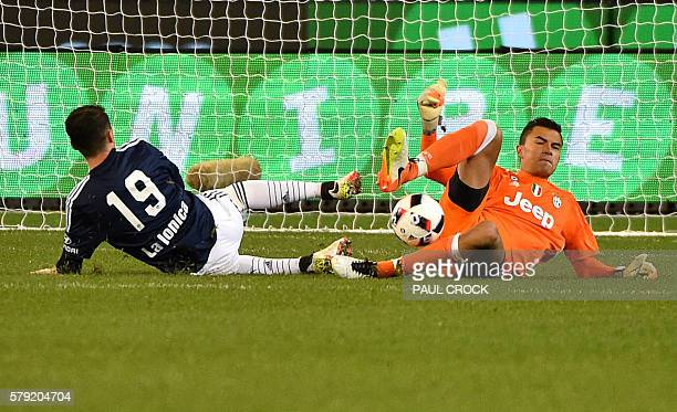 Juventus' goalkeeper Emil Audero makes a save after an attack by Melbourne Victory's George Howard during the International Champions Cup football...