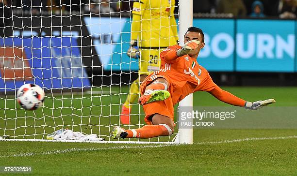Juventus' goalkeeper Emil Audero watches the ball head into the goal in a pentaly shootout during the International Champions Cup football match...