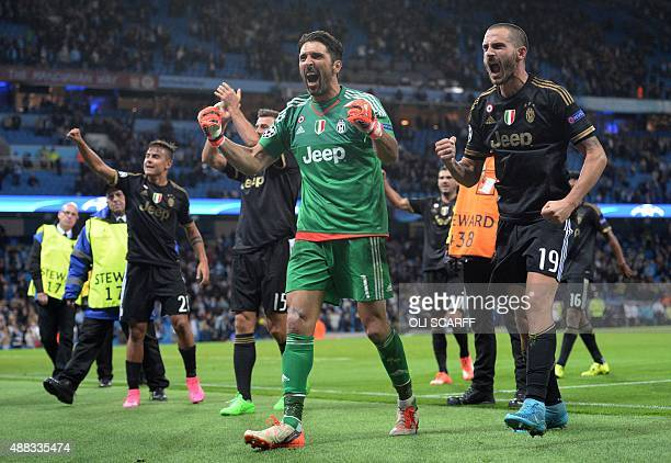 Juventus' goalkeeper from Italy Gianluigi Buffon and Juventus' defender from Italy Leonardo Bonucci celebrate after winning a UEFA Champions League...