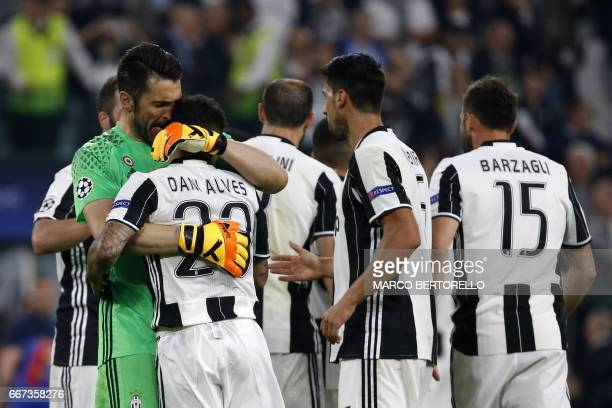 Juventus' goalkeeper from Italy Gianluigi Buffon and Juventus Defender from Brazil Dani Alves celebrate at the end of the UEFA Champions League...