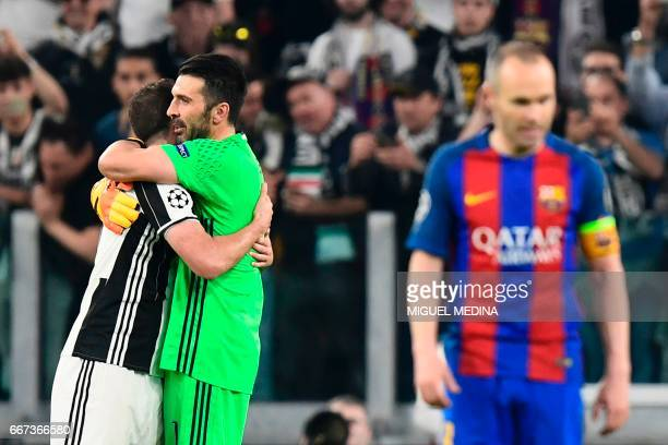 Juventus' goalkeeper from Italy Gianluigi Buffon and Juventus' forward from Argentina Gonzalo Higuain celebrate after winning the UEFA Champions...