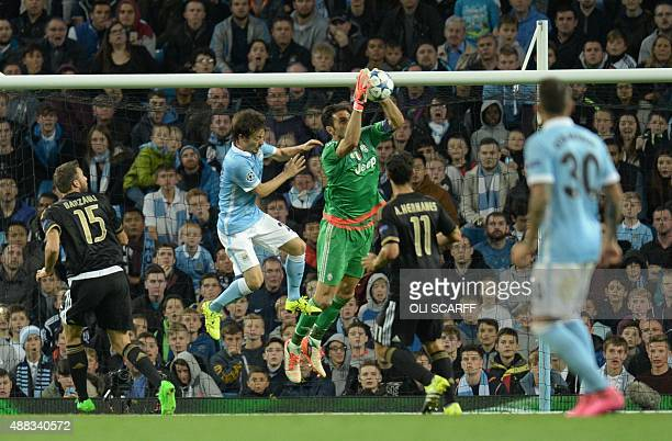 Juventus' goalkeeper from Italy Gianluigi Buffon blocks a cross during a UEFA Champions League group stage football match between Manchester City and...