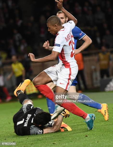 Juventus' goalkeeper from Italy Gianluigi Buffon blocks a shot on goal by Monaco's French forward Kylian Mbappe during the UEFA Champions League...
