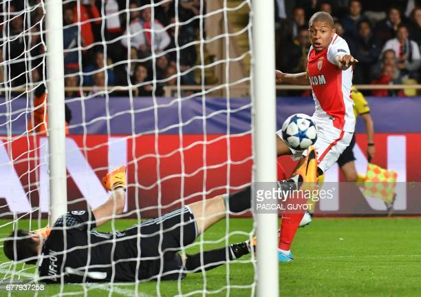 Juventus' goalkeeper from Italy Gianluigi Buffon blocks the ball from Monaco's French forward Kylian Mbappe during the UEFA Champions League...