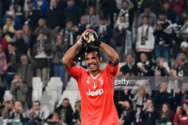 Juventus' goalkeeper from Italy Gianluigi Buffon celebrates at the end of the UEFA Champions League Group D football match Juventus vs Sporting CP at...