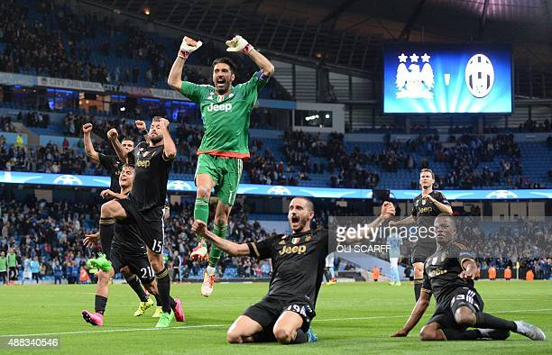 Juventus' goalkeeper from Italy Gianluigi Buffon celebrates with teammates after wining a UEFA Champions League group stage football match between...